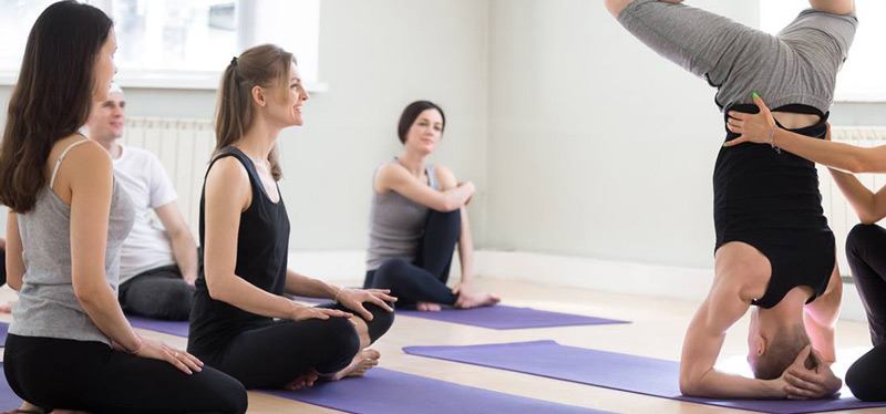 hands on yoga assist with yoga instructor. why niagara studio yoga by sarah is releasing consent cards
